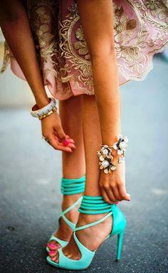Inside pink dress with golden threads handicraft with mint high heels