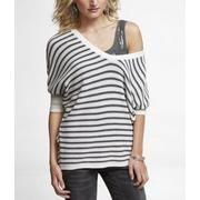 V-neck Shaker sweaters falling over one shoulder.  Alluring!