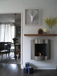 Love this little fireplace..
