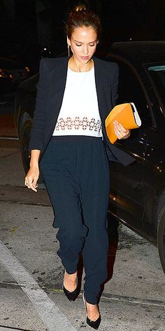 Love Her Outfit!   JESSICA ALBA   If you haven't tried laser-cut leather yet, this is the season to test the trend Alba tempers her Lovers + Friends crop top with a black blazer and loose-fitting pants. Bonus points for those shoes, which tie together the two shades of her outfit.