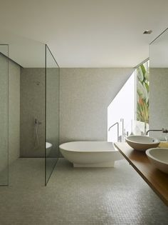 Shower glass with no door. Perfect tiles.
