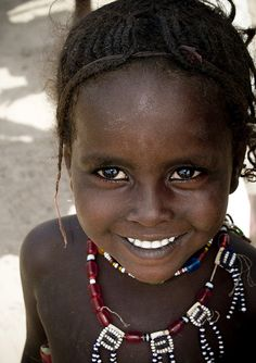 Young Afar girl smiling, Ethiopia by Eric Lafforgue, via Flickr