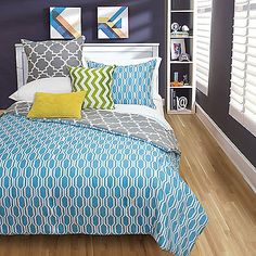 Give your little one's bed a smart new look with the handsome Brodie Reversible Comforter Set. Dressed in a blue face with a grey reverse, the 2-in-1 bedding is the perfect addition for any young man's bedroom.