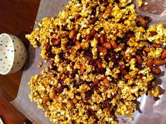 My family and I enjoy swapping recipes during the holidays. We normally email each other recipes and decide which ones we want to try prior to getting together. This year, my mom brought this cranberry-orange caramel popcorn to my sister's for Thanksgiving, and it was a huge hit. I enjoyed it so much that I want to share it with you today. Given the high sugar content, it's not the healthiest of holiday treats, but you can alter the amount of nuts and dried fruit in the recipe to change the nutritional value.    I loved this easy-to-make recipe so much that I made two batches of it when I returned to New York for a holiday party I attended. This delicious carmel caramel corn can be wrapped up easily in a pretty bag with a bow and gifted to friends, co-workers or as a special treat for the host of any holiday parties you are attending.