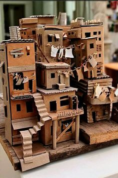 favela 3 // da trisbj - cardboard favela by pamela sullivan Cardboard City, Cardboard Sculpture, Cardboard Crafts, Paper Crafts, Cardboard Design, Cardboard Houses For Kids, Cardboard Mask, Cardboard Dollhouse, Cardboard Model