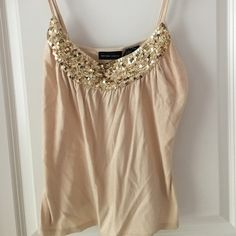 Cute summer top Cute New York & Company cream colored top with sequins. Great for a night out. New York & Company Tops Camisoles
