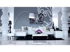 low slung white leather living room