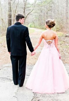 Take a picture standing looking like your walking down a long trail. Symbolic like walking into your future #prom #pictures #couple