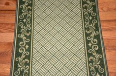 """Dark Spring Green Scroll Border Washable Non-Skid Carpet Rug Runner - Purchase by the Linear Foot by Dean Flooring Company. $10.00. This runner is sold here by the linear foot. One unit of quantity equals one foot of length on your runner. Width - Approximately 26"""". These beautiful carpet runners match our Dean Flooring Company stair treads. This item will be finished (serged with color matching yarn) on all four sides regardless of the length. It is made from nylon with a..."""