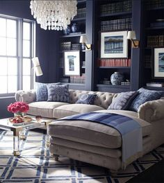 great tufted couch, muted blues and grays, lucite coffee table