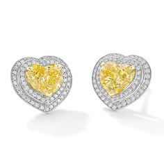 These Double Vintage earrings with heart-shaped yellow diamonds by Boodles are an incredible find by their gem buyer Jody Wainwright, as these rare Zimmi diamonds came from the mine in the same year in the same weight shape, and so were able to be made in to matching earrings. Find out more: http://www.thejewelleryeditor.com/shop/product/boodles-vintage-earrings-heart-shaped-yellow-diamonds-white-diamonds/ #jewelry