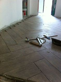 "Install a herringbone pattern with ""wood"" tile. - MyHomeLookBook"