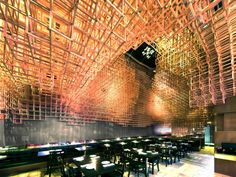 Innuendo Restaurant  by Bluarch Architecture + Interiors + Lighting  At a restaurant in New York, patrons dine under what seems like a massive three-dimensional game of Jenga.