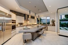 Modern Kitchen with High ceiling, Undermount Sink, LBL Lighting Cypree Large Low Voltage Pendant Light, Breakfast bar, Flush