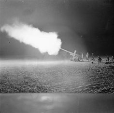 BRITISH ARMY NORTH AFRICA 1940-43 (E 14775)   4.5-inch field gun firing at night against enemy armoured concentrations at El Alamein, July 1942.