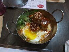 Gaja Atlanta  Rice Cakes. Made in-house, seaweed flavor, gochujang sauce, scallions, hot spring egg. Spicy. $6. | Yelp