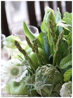 centerpiece with green apples, kale, mint, artichokes and asparagus.  Fleurs de France  www.fleursfrance.com