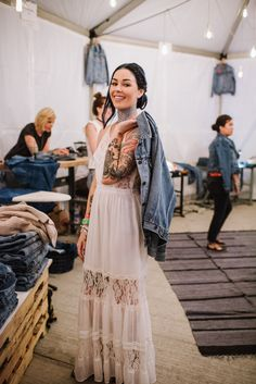Kristen Leanne, Founder & CCO of Arctic Fox Color, wore a bohemian lace maxi dress with her customized Levi's Trucker Jacket at Neon Carnival last weekend.