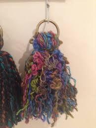 Resultado de imagen para borlas de lana