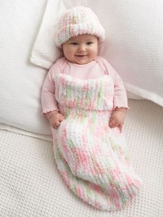 This adorable Knitting Pattern makes the softest, coziest Baby Cocoon and Hat ever when you use Bernat Pipsqueak Yarn.  Available in English and French.  Free download.