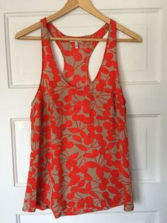 "Cherry print Joie tank top with chest pocket. Size small. Shoulder to shoulder: 10.5"". Length: 26.5"". 