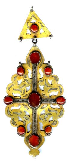Pin with hanging pendant, gilt silver and carnelian inlay, Turkoman componants. Designed by Linda Pastorino  SOLD  info@singkiang.com