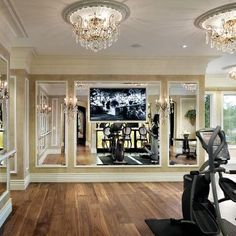 An exercise room that doubles as a ballroom dance floor. Hopefully I'll have room in my house for one of these (or at least the ballroom dance part).