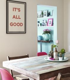 The print is the result of a collaboration between Maser and Damien Dempsey. The pink chairs are from Cult Furniture. The striped canisters are from TK Maxx.