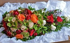 cream red orange bouquet | Autumnal tear drop bouquet of red, orange and cream roses, red tipped ...