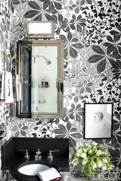 The medicine cabinet in the powder room of Erika Bearman's Miles Redd-designed home is by Restoration#Floral wallpaper Hardware, the fittings are by Waterworks, and the wallpaper is by Marthe Armitage. Tour the entire home here