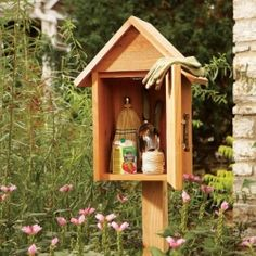 Build this simple storage cabinet right in your garden. It's an attractive feature and keeps small garden tools dry and close at hand.