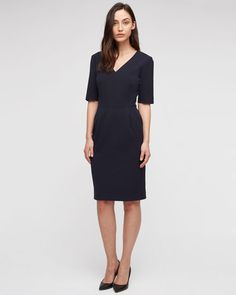 Refined short-sleeve dress meticulously crafted in a rich wool blend. Front-facing dart detail for a sleek silhouette, full lining, slant pockets and concealed zip and hook-and-bar closure. Expertly tailored using cloth from some of Europe's most prestigious mills, this suiting essential is perfect for your working wardrobe this season.