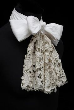 ca 1670-1690 man's large scale raise Venetian needle lace cravat, tied with added linen and silk ribbon. Made in Venice.