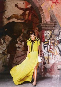 Yellow evening wear against artistic background
