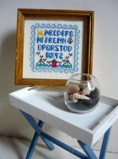 Hey, I found this really awesome Etsy listing at https://www.etsy.com/listing/181466301/dollhouse-miniature-needlepoint-sampler