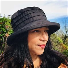 A waterproof women's rain hat in black polyester - smart enough for city rain as well as country downpours!  You'll find you wear it SO much (even when it isn't raining!)Its simple straightforward style makes it an ideal no frills everyday hat - and the medium sized brim will protect you from every drop of rain.Adjustable to fit almost all head sizes and strong enough to be crumpled up into a handbag and come out smiling!This is our LUCY LIGHTWEIGHT RAIN HAT:•Handmade in England from 100%… City Rain, Rain Hat, Simple Style, Hats For Women, In The Heights, England, Strong, Drop, Country