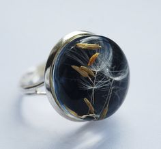 Black resin ring with real dandelion seeds inside crystal clear resin, with adjustable silver ring band by NaturalPrettyThings
