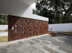 Image 31 of 44 from gallery of The Running Wall Residence / LIJO RENY architects. Photograph by Paveen Mohandas Decorative Concrete Blocks, Concrete Block Walls, Door Design, House Design, Fence Design, Exterior Wall Tiles, Compound Wall Design, Tropical Architecture, Modern Architecture