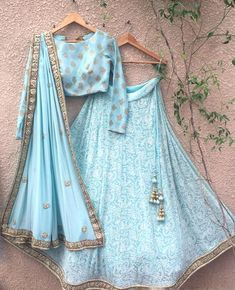 Exclusive Designer Anarkali design Raw Silk Wedding Lehenga and Choli with handwork embroidery work. This lehenga comes with matching Georgette dupatta with zari work border. Blue Lehenga, Lehenga Choli, Sky Blue Saree, Pakistani Lehenga, Floral Lehenga, Silk Dupatta, Indian Wedding Outfits, Indian Outfits, Wedding Attire