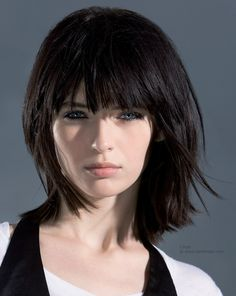 Long, trendy bob... Long and textured bob. A beveled cutting line close to the shoulders, long layers and textured tips produce an airy, elegant hairstyle with a round distribution of the volume and a flattering line around the face. Deep bangs.