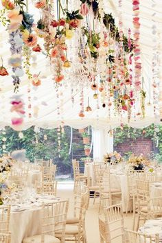 Blooms Hanging from the ceiling create a gorgeous display over the wedding tables