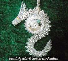 Beads4Geeks: Crystal Swarovski Beaded Dragon Pendant. Made with Toho Round seed beads and Swarovski crystals. Available on Etsy: https://www.etsy.com/listing/200736313/white-swarovski-crystal-beaded-dragon?