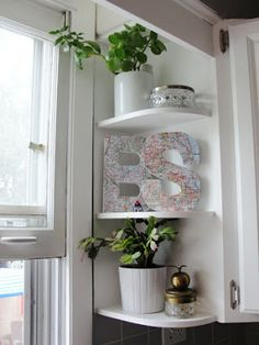 If I can't have a deep window ledge above the sink, perhaps we could do shelves like these....