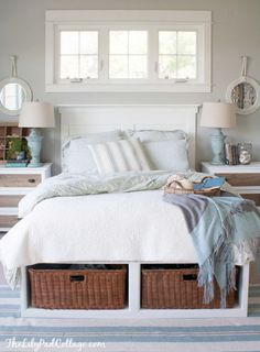 If you want to keep your storage under wraps, toss your comforter  (or an extra blanket) over a bench full of baskets to hold pillows. It'll blend right into your bedding. See more at The Lily Pad Cottage »