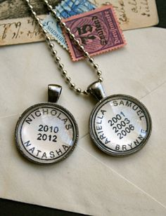 Personalized name necklace in old-fashioned postmark style - for children's names, wedding, locations and more; by CrowBiz. Also available as a key ring.