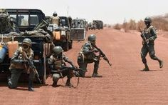 """Malian soldiers secure a road between Goundam and Timbuktu, northern Mali, on June 2, 2015, during a joint operation """"La Madine 3""""/AFP"""