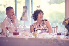 Mother of the groom laughs at wedding speeches at italian villa wedding photographs. Photography by one thousand words wedding photographers