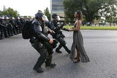 Protester Ieshia Evans is detained by law enforcement near the headquarters of the Baton Rouge Polic... - REUTERS/Jonathan Bachman