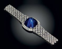 Sapphire and Diamond Bracelet - by Mouwad - 180.86 ct sugarloaf cabochon  sapphire - 50.36 cttw diamonds - 18 k gold -  $932,500 at auction