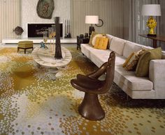 Notice the long, low sofa with pillows, dotted rug, octagonal foot rest/seat, sun lamp.    Abernathy House, William Cody